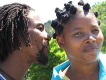 African whisper. African american man whispering in the ear of an african american woman Royalty Free Stock Photos