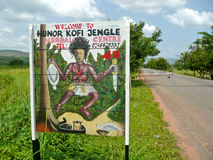 African Witch Doctor Sign. A roadside sign advertising a witch doctor near Kpong in Ghana, West Africa Royalty Free Stock Images