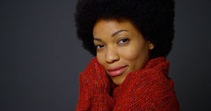 African woman with afro wearing red shawl Royalty Free Stock Image