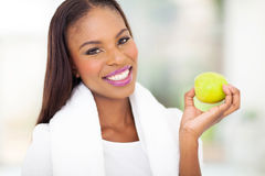 African woman apple Royalty Free Stock Images