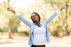 African woman arms outstretched Stock Photos
