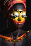 African woman with artistic ethnic makeup Stock Photos