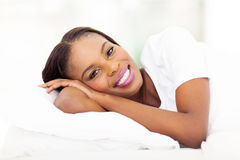 African woman bed stock photography