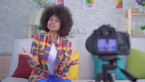 African woman blogger with an afro hairstyle before the camera close up stock video footage