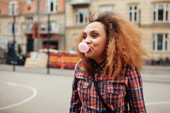 African woman blowing bubble gum Royalty Free Stock Photo