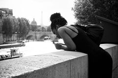 African woman in border Seine river Royalty Free Stock Photo