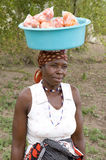 African woman with bowl on head stock image