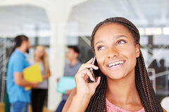 African woman calling with smartphone Stock Images