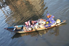 African woman on a canoe Royalty Free Stock Photos