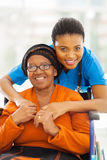 African woman caregiver. Portrait of senior african disabled women and her caregiver Stock Photos
