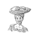 African woman carries a basket with baobab fruits on her head. Vector vintage engraved illustration isolated over white Stock Image