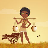 African woman carries water Stock Photography