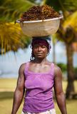 African woman carry things on her head Royalty Free Stock Image
