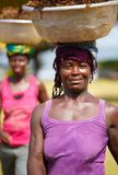 African woman carry things on her head Royalty Free Stock Photography