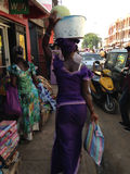 African woman carrying a basket Royalty Free Stock Photo