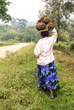 African woman carrying jack fruits on her head Stock Photography