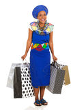 African woman carrying shopping Stock Photography