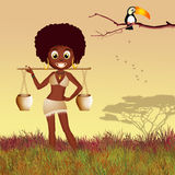 African woman carrying water Royalty Free Stock Photo