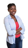 African woman with casual clothes and crossed arms Stock Images