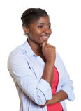 African woman with casual clothes looking sideways Royalty Free Stock Image