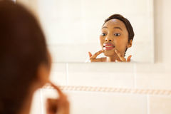 African woman checking pimple Stock Photo