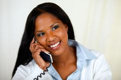 African woman conversing on phone Royalty Free Stock Photo