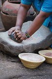 African woman cooking maize meal at tribal house. African woman cooking maize meal at tribal house,South Africa Stock Photography