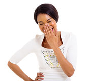 African woman covering her mouth and laughing. Happy african woman covering her mouth and laughing isolated on white background Stock Photo