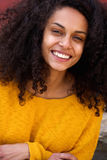 African woman with curly hair and beautiful smile Royalty Free Stock Image
