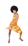 African woman dancing. Is summer time, people are dancing, colorful clothes and happy faces Royalty Free Stock Photo