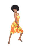 African woman dancing. Is summer time, people are dancing, colorful clothes and happy faces Stock Photo