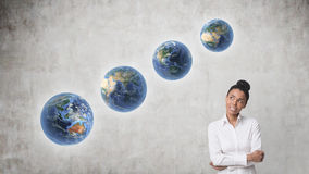 African woman with diagonally aligned planets Stock Images