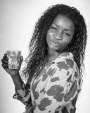 African woman drinking coffee. African american teen drinking a cup of coffee stock photos