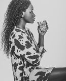 African woman drinking coffee. African american teen drinking a cup of coffee royalty free stock photography