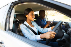 African woman driving. Beautiful african women taking driving test stock photography