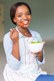 African woman eating stock photo