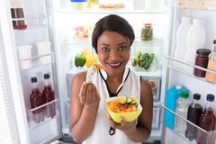 Free African Woman Eating Fruits In Bowl Stock Image - 124744321