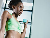 African woman exercising with small weights in gym Stock Photography