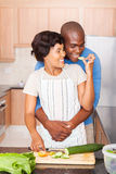 African woman feeding boyfriend Royalty Free Stock Images