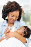 African woman feeding daughter Stock Photography