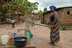 Free African Woman Fetching Water Royalty Free Stock Images - 44695449