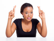 African woman fingers crossed Royalty Free Stock Images