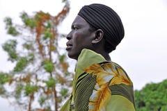 African Woman Gazing Off Into The Distance. GULU, UGANDA, AFRICA - CIRCA JANUARY 2009:  Unidentified woman gazing off into the distance circa January 2009 in Royalty Free Stock Photo