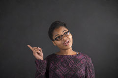 African woman good idea on blackboard background Royalty Free Stock Photo