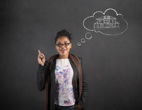 African woman good idea dream house on blackboard background Stock Photos