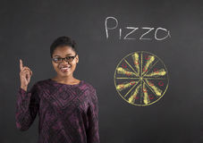 African woman good idea for pizza on blackboard background Stock Image