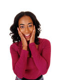 African woman with hands on face. Stock Photos