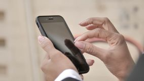 African Woman Hands Using Smartphone Outdoor. The African Woman Hands Using Smartphone Outdoor, high quality stock footage