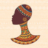 African woman head. The bright decorative vector illustration with African patterns. Can be used in fabric design for making of clothes, accessories, creating stock illustration