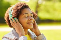 African woman in headphones listening to music Stock Photography